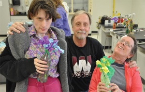 Terry Martin and his new friends display the flowers resulting from an art therapy session in 2011. (Photo by Maddie Meyer)